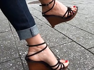 very very hot feet walks in street