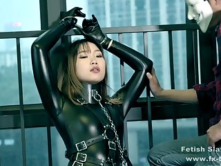 bondage leather catsuit girl on single gloves