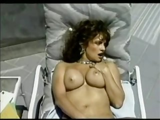 ashlyn gere masturbating while lying on sun lounger
