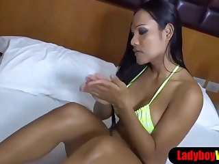 ladyboy puts on some body oil before she gets fucked
